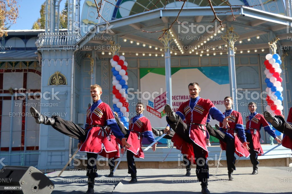 The Cossack dance with sabers in traditional clothes. Pyatigorsk, Russia stock photo