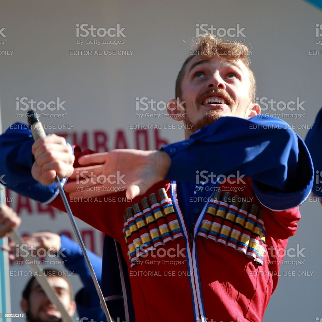 The Cossack dance with sabers in traditional clothes. Russia stock photo