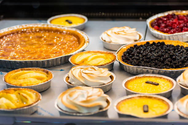 the counter of the cafeteria with different desserts stock photo