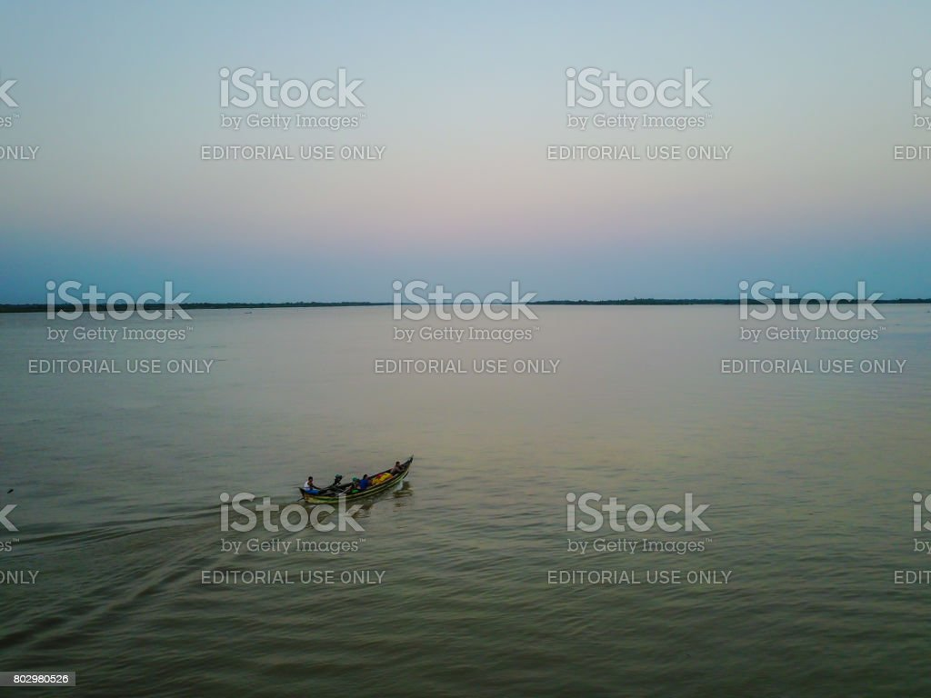 The countryside area where they use a small boat as a trasnport vehicle. stock photo
