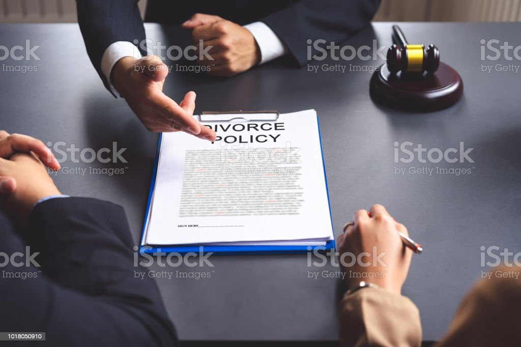 The couple consulting a lawyer about agreement on the divorce. Lawyer...