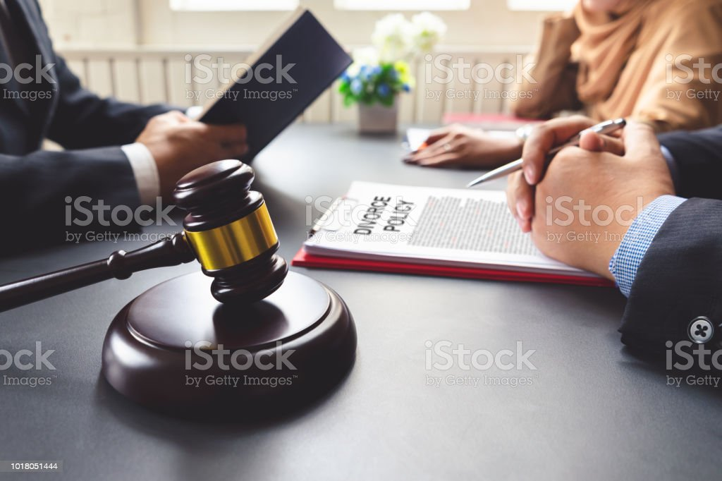 The couple consulting a lawyer about agreement on the divorce.
