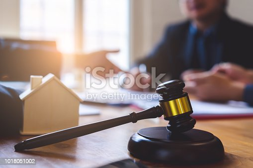 938640610 istock photo The couple consulting a lawyer and each blank white documents for graphic montage. 1018051002