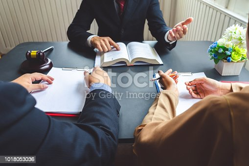 938640610 istock photo The couple consulting a lawyer and each blank white documents for graphic montage. 1018053036