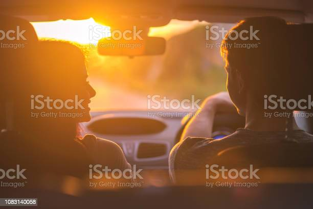The couple drive a car on the background of the sunset picture id1083140058?b=1&k=6&m=1083140058&s=612x612&h=ptduftsvwkjsy7zk04ys5as9dyqpd7nat10kh3x0eno=