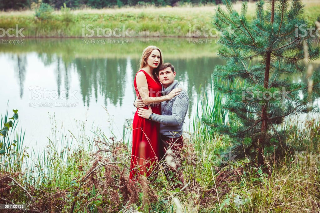 The couple is sitting by the lake foto stock royalty-free