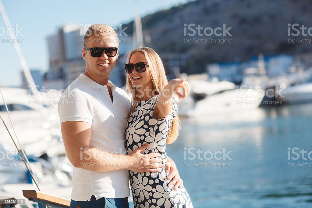 The couple on the pier near the yacht port foto royalty-free