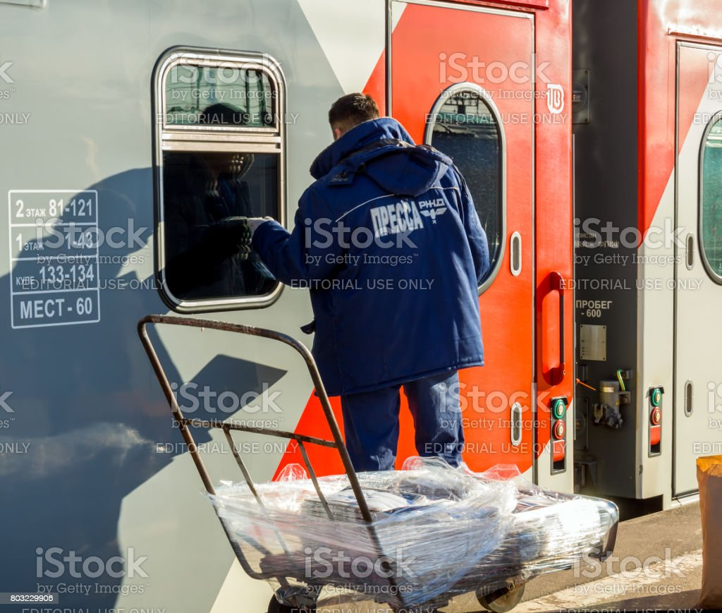 The courier brought the fresh press to the departure of the train 'Voronezh-Moskva' stock photo