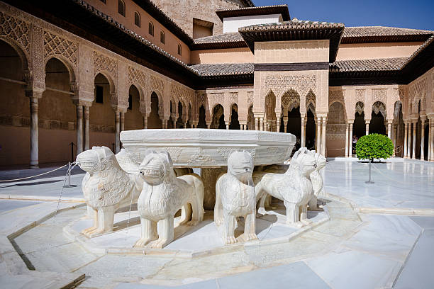 The Court of Lions, Granada, Alhambra, Spain the Court of Lions at the 13th century Alhambra Palace in Granada Spain. Beautiful arches and Arabesque Architecture palacios nazaries stock pictures, royalty-free photos & images
