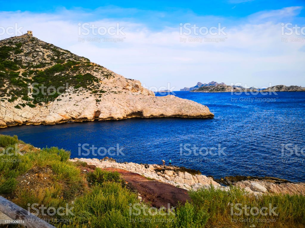 The cove of Callelongue in Marseille The Calanque de Callelongue is the first calanque in the Marseilleveyre massif between Marseille and Cassis. It is located at the southeast end of the 8ᵉ arrondissement of Marseille, in the Goudes district at the end of the seaside road, after the village of Goudes. At The Edge Of Stock Photo