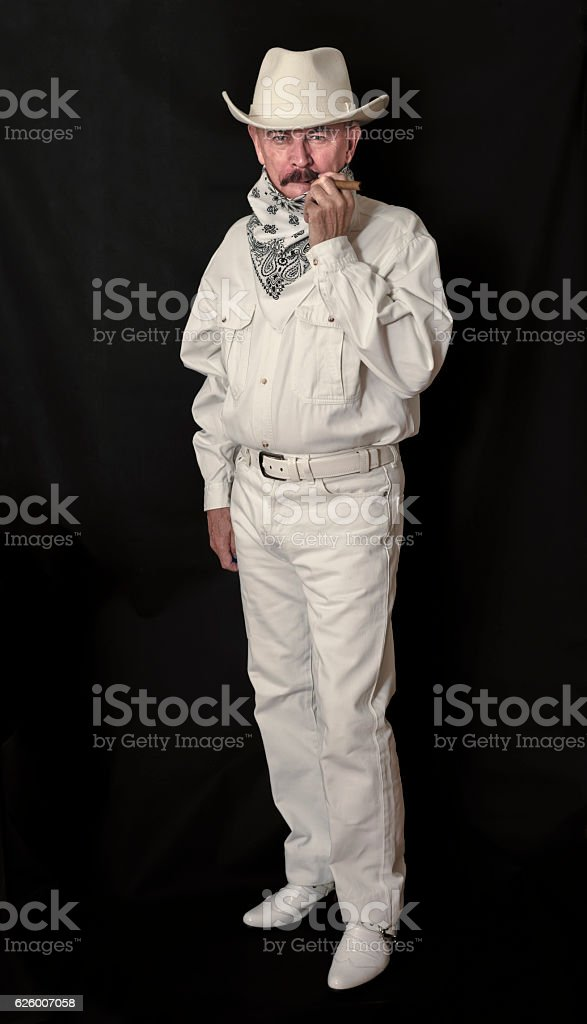 The cowboy with mustache in a white hat smoking cigar stock photo  sc 1 st  iStock & Royalty Free Hillbilly Men Mature Adult Cowboy Pictures Images and ...