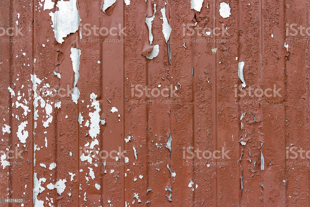 The cracked brown paint on an old metallic surface. royalty-free stock photo