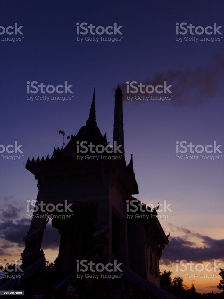 The cremation in the countryside of Thailand began at twilight. stock photo