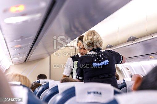 823006998 istock photo The crew serves passengers on board 1023437794