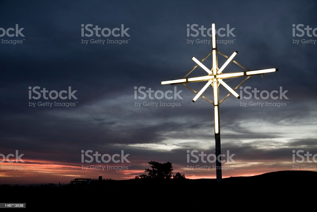 The cross neon lights landscape royalty-free stock photo