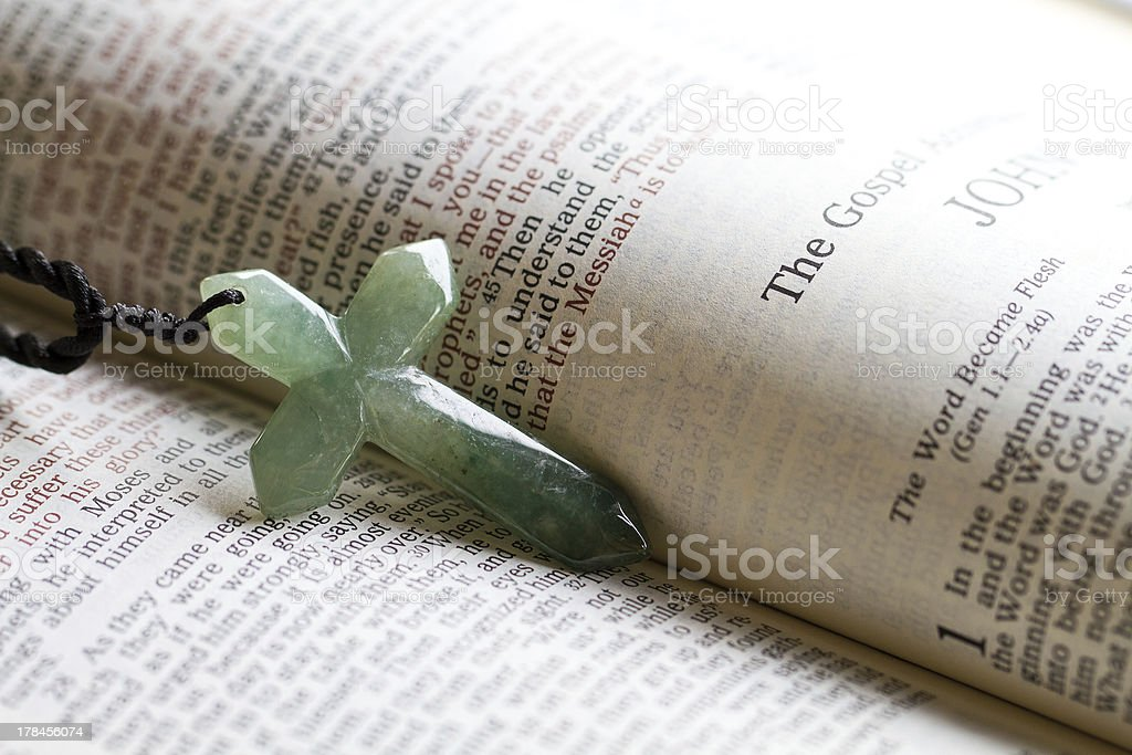 The cross on a bible passage stock photo