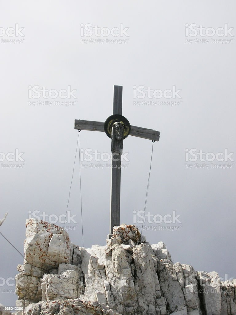 The Cross with Head of Jesus on the Paternkofel Peak. The End of Great Via Ferrata in Sexten Dolomites. stock photo