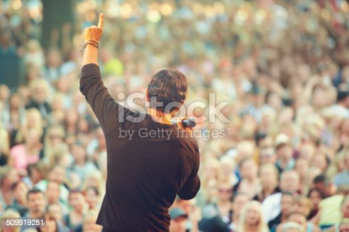 A singer performing in front of a massive crowd at a concerthttp://195.154.178.81/DATA/i_collage/pi/shoots/782677.jpg
