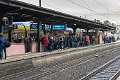 The crowd of people is waiting for the next train on the platform in Uelzen.
