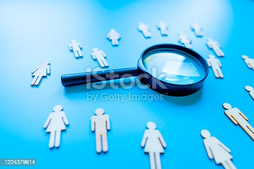898212112 istock photo The crowd of wooden figures of people. Concept of business team. Labor collective. Teamwork. Employees. Human Resource Management. Labor market. Demographic situation. Population 1224379614