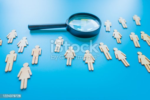 898212112 istock photo The crowd of wooden figures of people. Concept of business team. Labor collective. Teamwork. Employees. Human Resource Management. Labor market. Demographic situation. Population 1224379728