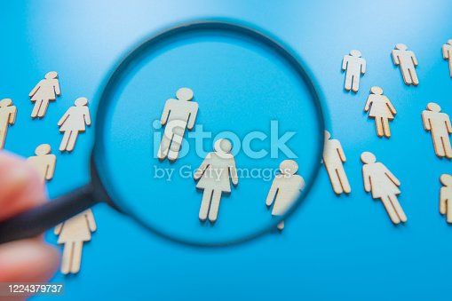 898212112 istock photo The crowd of wooden figures of people. Concept of business team. Labor collective. Teamwork. Employees. Human Resource Management. Labor market. Demographic situation. Population 1224379737