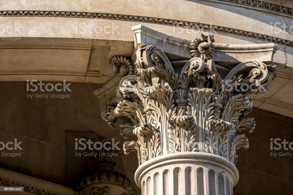 The crown of a pillar with fine sculpture details stock photo