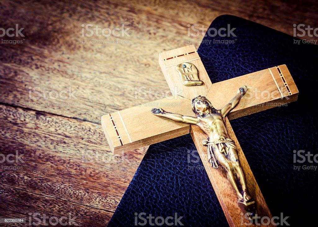 the crucifix on black book stock photo