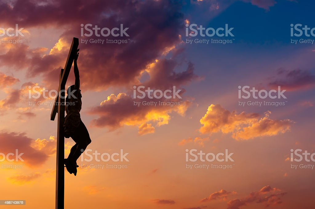 The crucifixion of Jesus over dramatic sky stock photo