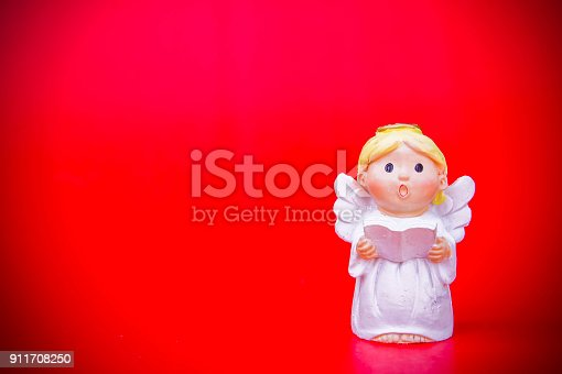 istock the cupid doll for the love on red background and copy space in the concept valentine's day background 911708250