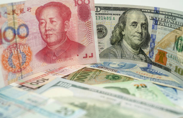 the currencies of dollar and yuan stock photo