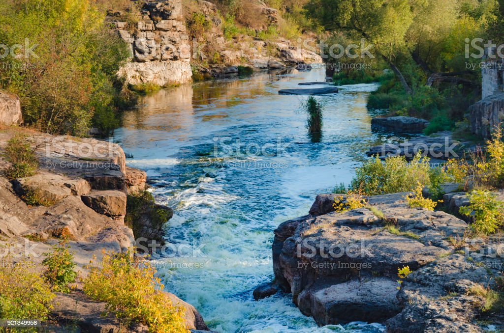 the current of the river among the stones stock photo