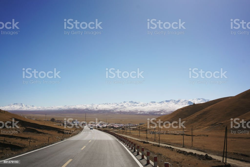 The curved Qilian mountain road, Gansu Province stock photo