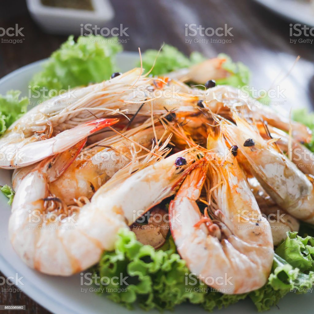 The customers ordered shrimp to burn salt during the trip to the beach in famous restaurants stock photo