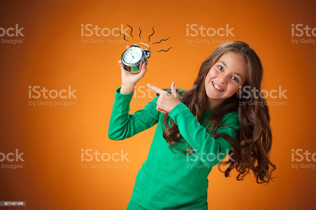 The cute cheerful little girl on orange background photo libre de droits