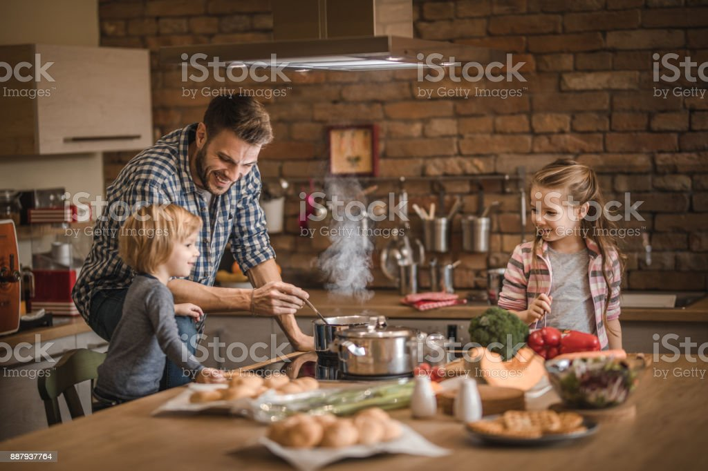 The cutest assistance in the kitchen! stock photo