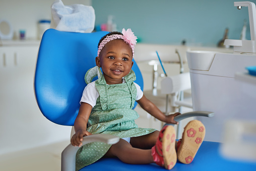 Shot of an adorable little girl sitting in a dentist's chair