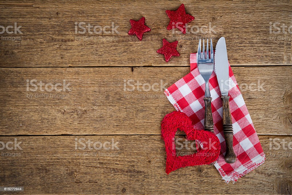 the cutlery on the table in santa hat stock photo
