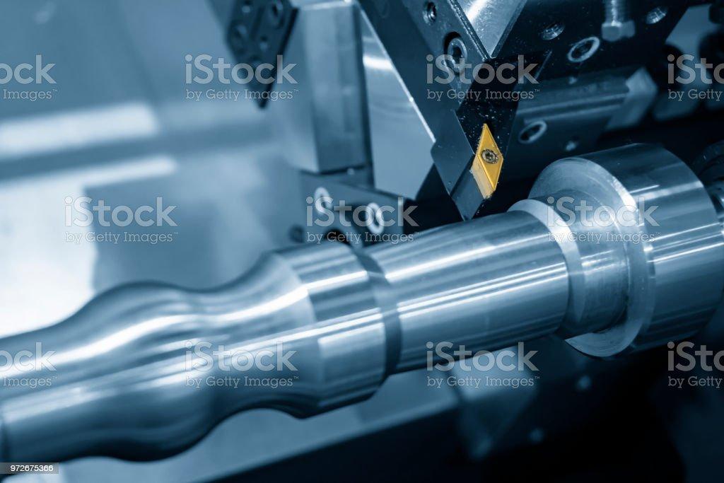 The cutting tool of CNC lathe machine or turning machine cutting the...