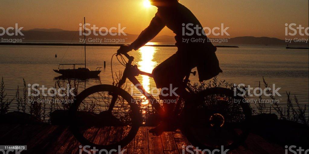 die Radfahrerin - Lizenzfrei Burlington - Vermont Stock-Foto