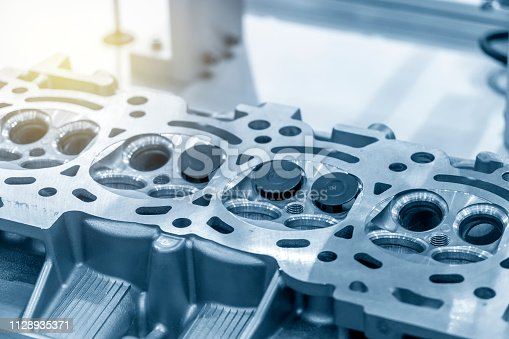 istock The cylinder head repairing process. 1128935371