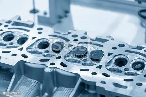 istock The cylinder head with the valve in the light blue scene. 1010755632