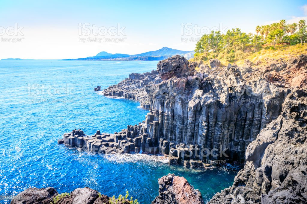 The Daepo Jusangjeolli basalt columnar joints and cliffs on Jeju Island stock photo