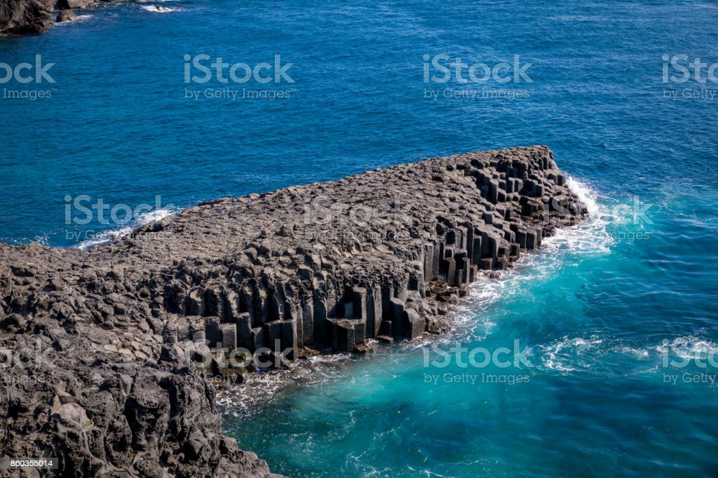 The Daepo Jusangjeolli basalt columnar joints in Jeju Island, South Korea stock photo
