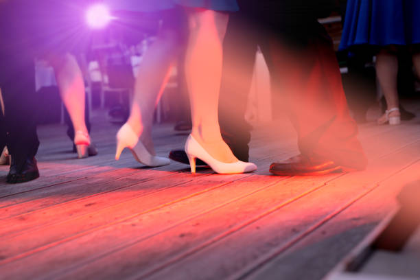 the dance floor with people dancing under the colorful lights - dance floor stock photos and pictures