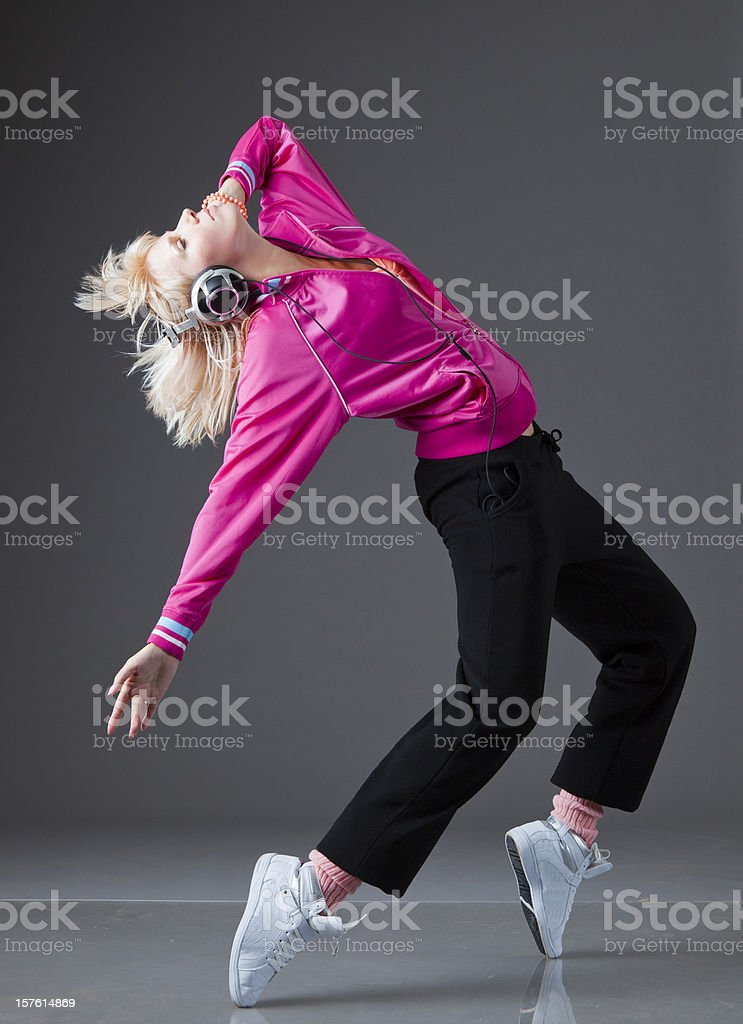 The Dancer dancing and listening music with Headphones stock photo