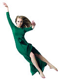 Dancer in green dress isolated on white