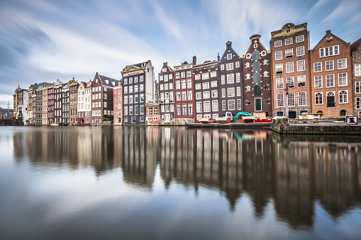 istock The Dancing Houses of Damrak Canal 1021485630