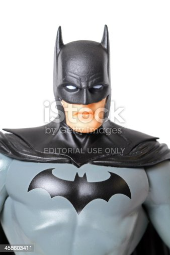 Vancouver, Canada - April 9, 2012: An action figure model of Batman, sculpted by Paul Harding and released by DC comics, against a white background.