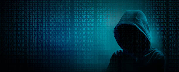 the dark web young hacker with hood and binary code computer crime stock pictures, royalty-free photos & images